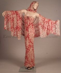 Frowick, Roy Halston,.  C. 1970s, Evening dress, Bias draped chiffon printed in red and white large floral motif. Small and large shawl included.