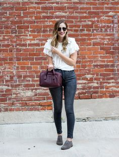 Fall outfit idea // ruffle sleeve top, black skinny jeans, suede oxford shoes and leather satchel