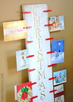 Christmas Card Holder using a 2x10 + spray painted clothes pin.  Easy to make and is a beautiful way to display your holiday cards