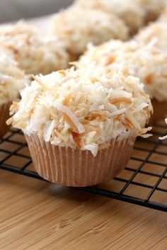 Coconut Cupcakes with Coconut Frosting - I made these in the spring with organic ingredients. My administrative assistant said that they were the best cupcakes that she ever had -- this is in an office that regularly gets DC and Magnolia cupcakes! Coconut Frosting, Coconut Cupcakes, Yummy Cupcakes, Coconut Milk, Toasted Coconut, Coconut Muffins, Cheesecake Cupcakes, Mini Cupcakes, Raspberry Frosting