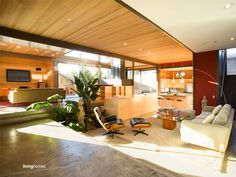 LivingHomes Designed by award-winning architects, LivingHomes houses have a classic mid-century modern vibe. How pretty is this living room?  Read more: http://www.purewow.com/slideshow/national/6145/Prefab-houses-have-become-pretty-fabulous.htm#slideNum=5#ixzz2W3jZvoCU