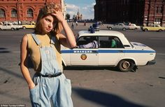 Hard times: Eighteen-year-old prostitute Katya scours the street for work as a police car drives past in Moscow in 1991 shortly before the collapse of the USSR  Peter Turnley/CORBIS