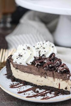 This No-Bake Mudslide Pie has an Oreo cookie crust filled with a no-bake Kahlua mousse and then a layer of no-bake Baileys Irish cream mousse. Topped off with whipped cream Oreos and hot fudge, this Mudslide pie is the out of this world!