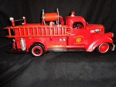 """This is a 1941 Mack Fire Truck This is hand made, hand painted. It is very nicely detailed with fire hoses, siren light, ladder, fire extinguisher, shovel, etc. It has wording is that reads """"Volunteer"""