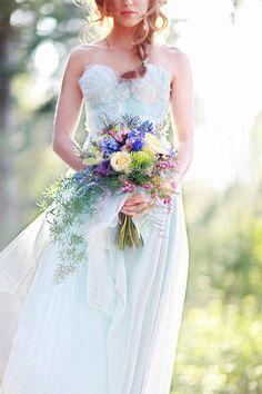 Delicate pale blue wedding dress