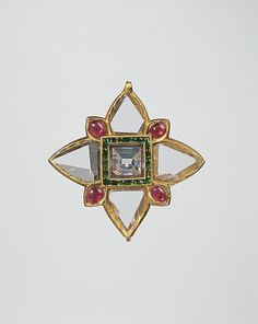 Quatrefoil Pendant. first quarter 17th century. Islamic. Floral Pendant with Upswept Petals (first half 17th century, Islamic) Fabricated from gold; worked in kundan technique and set with diamonds, rubies and emeralds.