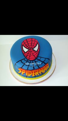 Spiderman face cake with blue background
