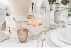 winter wedding inspiration by www.tabeamarialisa.ch | photo: www.andreakuehnis.com table decoration / peach white green flowers / white wooden candle holder / vintage