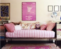 I love this for a young girl's room.  It's not too age specific.  A trundle bed was always something I wanted growing up.  It acted as a sofa as much it did a bed, and it required lots of pretty throw pillows!  Generally, a mattress on wheels fits beneath the bed which is ideal for sleepovers!