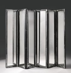 SERGE ROCHE SIX-PANEL SCREEN mirrored glass and lacquered wood 87 1/8  x 19 5/8  x 1 1/4  in. (221.3 x 49.8 x 3.2 cm) circa 1940