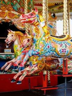 Extremely colorful carousel horses!  But what struck me about this merry-go-round is they're going in the wrong direction.  All carousels I've ever seen go counter clockwise.