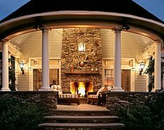 Outdoor fireplaces.  I could live on this porch!  (as long as I had bug spray!)
