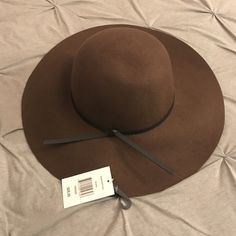 Brown floppy hat NWT, real cute floppy hat. Purchased at JCPenney. Manhattan Hat Company Accessories Hats