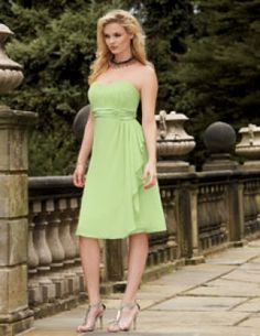 Jordan 158.   Knee length chiffon dress with gathered strapless bodice. Overskirt is draped to the side and waist is highlighted with ruched satin. The removable spaghetti straps are included. Available in short, knee and floor lengths.