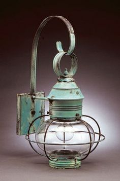 "Beach Cottage Decor - Lantern - 8"" Onion Wall Fixture Caged in Verdigris  Item #: nel-2531verdigris - $428.00 - Medium Onion Wall 8"" Globe - Caged Medium Base Socket Dimensions: 11""W x 12""D x 19""H Backplate: 4.5""W x 5.5""H Mounting Height: 13.5"" **Note: Mounting Height is from the center of the backplate to the top of the fixture. Pictured with Verdi Gris Finish"
