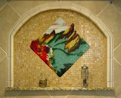 Boulder's dramatic Flatirons formation in the fall forms the basis for this traditional backsplash mural in a classic setting.