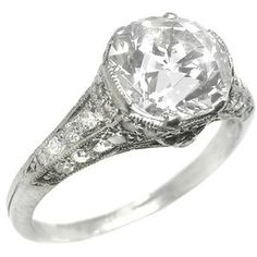 Estate diamond ring, I like that the prongs don't stick out much- it keeps the focus on the right details