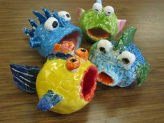 "4th grade ceramic fishes; approx. 4""---7"" long; lesson by art teacher: Susan Joe"
