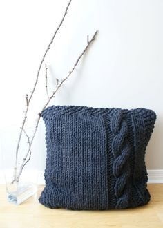 """This 27"""" x 27"""" (approx.) Super Chunky Cable Knit pillow cover is knit using multiple strands of acrylic yarn to create a modern over-sized p..."""