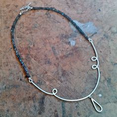 Shot from my bench of the twirly labradorite and silver necklace