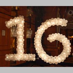 these balloons and lights are such a ute decoration... this could be used for the outside of the place my sweet 16 takes place at <3 love it and adore this decoration so much!!!!!! <3 <3