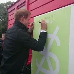 Prince Harry signs the Student volunteer army community shed at the university of Canterbury,Christchurch.5/12/2015
