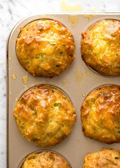 Overhead photo of golden Savoury Cheese Muffins in a gold muffin tin.