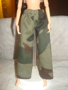 """""""Barbie Doll Separates- Elastic waisted military camoflage print pants""""...  I'm not to sure where to start!"""