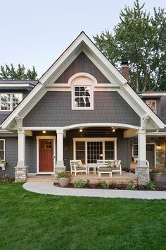 Dark Grey exterior paint with white trim - Kendall Charcoal - BM, wooden doors. Exterior board and batten/shutters wood