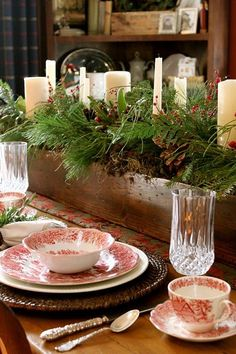a rustic Christmas tablescape with woven chargers, printed napkins, potted blooms and pears - DigsDigs Christmas Decorations For The Home, Christmas Table Settings, Christmas Tablescapes, Christmas Centerpieces, Holiday Tablescape, Christmas Candles, Noel Christmas, Country Christmas, Winter Christmas