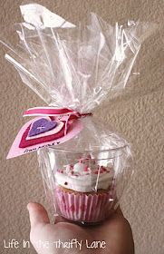 cupcake as a party favor-place in clear plastic cup, insert into bag, tie shut with a cute ribbon/tag