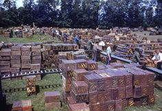 Local French citizens help US soldiers run an ammunition dump after the successful invasion of Normandy, august 1944.