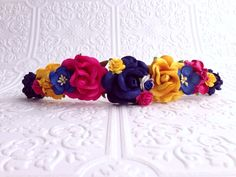 Find the piece here: https://www.etsy.com/listing/203455454/the-pink-navy-and-yellow-goddess-floral