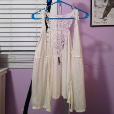 Cream colored vest with lace back. Cream vest with tie in the middle. Small stain, barely noticeable on the bottom right. Other then the stain, in great condition. Charlotte Russe Jackets & Coats Vests