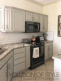 Mindful Gray Kitchen Cabinets - A before and after makeover of kitchen cabinets in Sherwin Williams' Mindful Gray. Kitchen Cabinets Decor, Farmhouse Kitchen Cabinets, Kitchen Cabinet Colors, Cabinet Decor, Painting Kitchen Cabinets, Kitchen Colors, Cabinet Ideas, Cabinet Makeover, Gray Cabinets