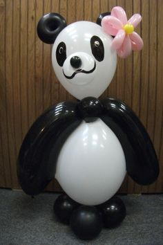 Balloon Panda Bear designed by Balloons by Night Moods in Juneau Alaska. We can also make her into a him by taking off the flower and putting on a bow tie. 907-523-1099 www.juneausbestballoons.com