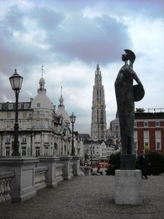 Minerva statue in Antwerpen The Minerva statue was made in 1958 by Marcello Macherini. Minerva is the Roman goddess of wisdom and the fine arts. In the background, the towers of the cathedral. Antwerp, Belgium