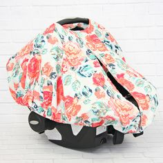 This fun and modern coral and navy baby canopy cover in a floral print is the perfect replacement for that blanket you have been using to cover your precious little one.  Our car seat canopy covers have an elastic bottom that fits securely around almost any infant car seat and is super easy to get on and off.