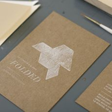 Stamped cards on chipboard.