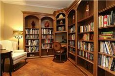 LIBRARY:  Hardwood floors and custom bookshelves set the mood for the perfect spot for reading a book or writing a note at the built-in corn...