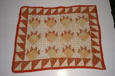 ANTIQUE DOLL QUILT W/PAW PRINT PATTERN AND RED BORDER