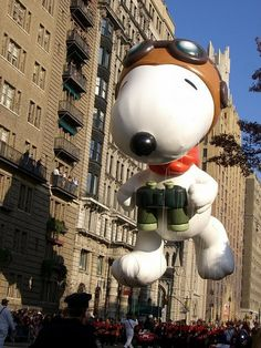 Snoopy Balloon - More balloons and floats; less singing and dancing! Ugh. Take it back old school, Macy's.