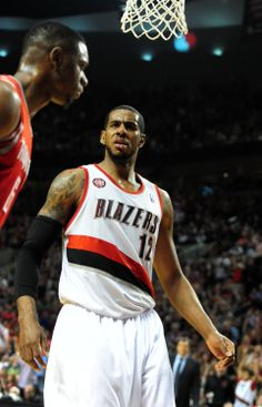 PORTLAND, OR - MAY 2: LaMarcus Aldridge #12 of the Portland Trail Blazers reacts after dunking the ball in the fourth quarter of Game Six of the Western Conference Quarterfinals against the Houston Rockets during the 2014 NBA Playoffs at the Moda Center on May 2, 2014 in Portland, Oregon. Moda Center, Lamarcus Aldridge, Western Conference, Portland Trailblazers, Trail Blazers, Nba Playoffs, Houston Rockets, Portland Oregon, Game