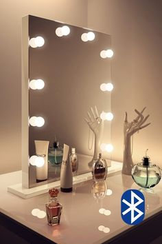 The Elizabeth Taylor Hollywood Mirror is an amazing addition to your dressing table... H80cm x W60cm Features; 13x 3W golf ball LED bulbs Dimmer switch (right h