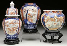 """Late 19th/early 20th century, Japan. Group of three Imari ware pieces consists of two covered jars and a vase with decoration of flowers, figures, and brocade patterns. SIZE: Largest is 10"""" t. PROVENANCE: Piczon collection"""