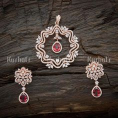 Designer Zircon Pendant Earring Set studded With synthetic CZ & ruby stones plated with Rose gold polish and made of copper alloy! Jewelry Design Earrings, Gold Earrings Designs, Gold Jewelry, Ruby Pendant, Pendant Set, Stylish Jewelry, Fashion Jewelry, Gold Polish, Bridal Jewelry Sets