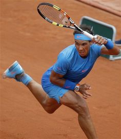 Rafael Nadal in action in the first round at Roland Garros Nadal Tennis, French Open, Tennis Stars, Rafael Nadal, Athletic Men, Pretty Men, Tennis Players, Tennis Racket, Sport Outfits
