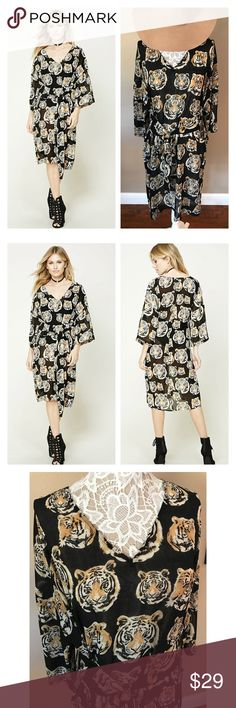"""Tiger print kimono midi dress Chiffon  midi dress features a drapey silhouette, an allover tiger face print, a V-neckline, dropped shoulders, wide 3/4 sleeves, a self-tying waist, and a vented hem. Semi sheer. Polyester. Bust 42"""", length 54"""". Nwt medium but runs big so can fit a large Forever 21 Dresses Midi"""
