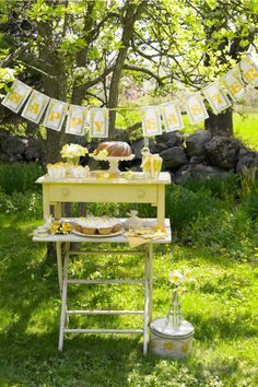 "Hosting an outdoor affair? Use a vintage side table to display a variety of Easter cakes and desserts that guests can help themselves to. A homemade ""Happy Easter"" banner makes everything extra festive!"