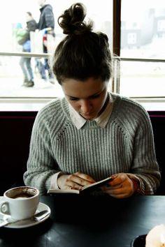 Top-knot bun, coffee shop, and a book. No comparison.